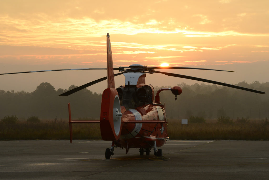 An MH-65 Dolphin helicopter sits at sunrise at Coast Guard Air Station Atlantic City. This AIRSTA aircrews utilize the MH-65 Dolphin helicopter for search and rescue, law enforcement, and national security missions. USCG photo by Petty Officer 1st Class Nick Ameen