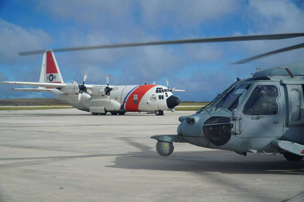 Coast Guard HC-130 Hercules Air Station Barbers Point rescue 8 fishers, USCG photo.