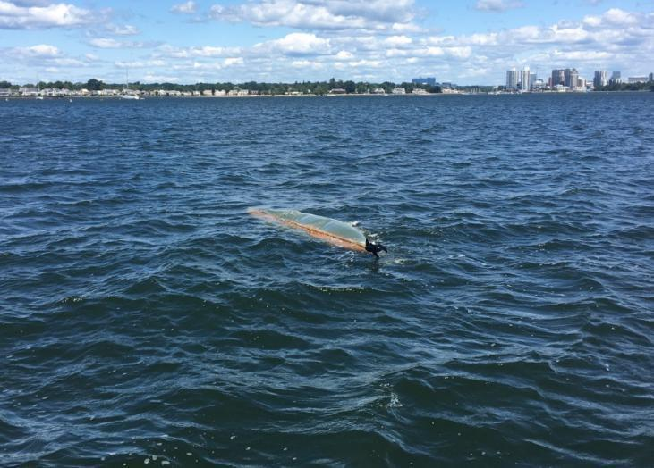 A capsized canoe drifts through Stamford Harbor, Conn. The Coast Guard searched for the owner with negative results until sunset, at which time the search was suspended. (Photo by U.S. Coast Guard).