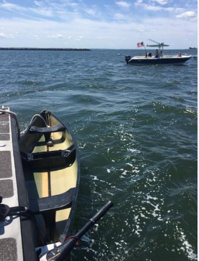An unmanned canoe sits in Stamford Harbor, Conn. The Coast Guard searched for the owner with negative results until sunset, at which time the search was suspended. (Photo by U.S. Coast Guard)