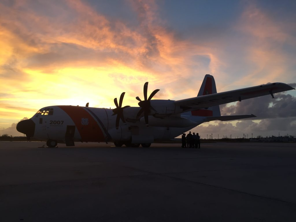 Coast Guard HC-130J Air Station Elizabeth City, USCG assists four boaters