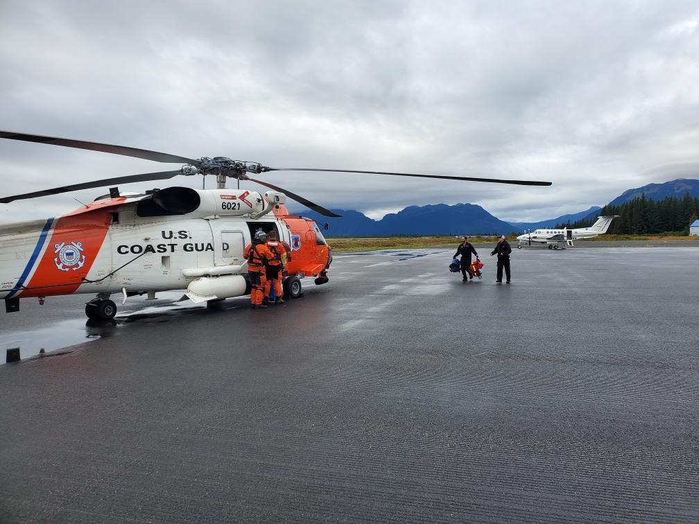 A Coast Guard Air Station Kodiak aircrew medevacs a cruise ship passenger, MH-69 Jayhawk Aircrew