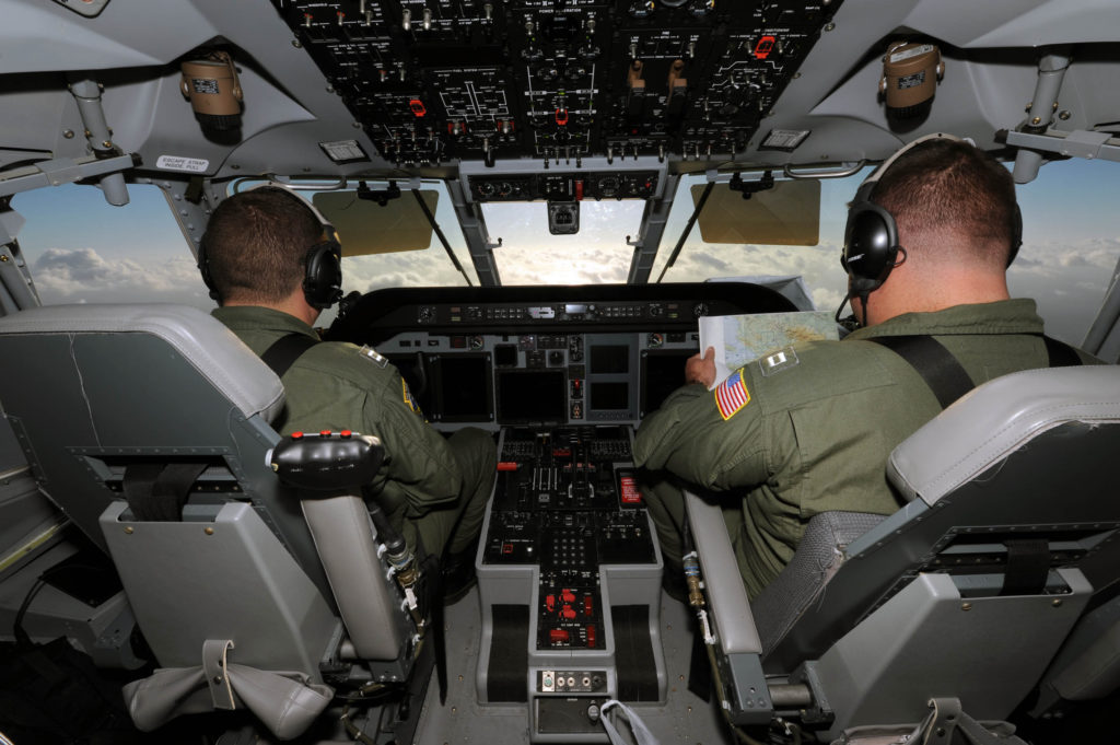 HC-144 Ocean Sentry pilots from Aviation Training Center Mobile. USCG search aircraft pilot