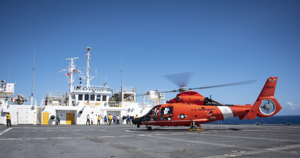 MH-65 Dolphin helicopter from Coast Guard Air Station Barbers Point, USCG rescue Maui divers