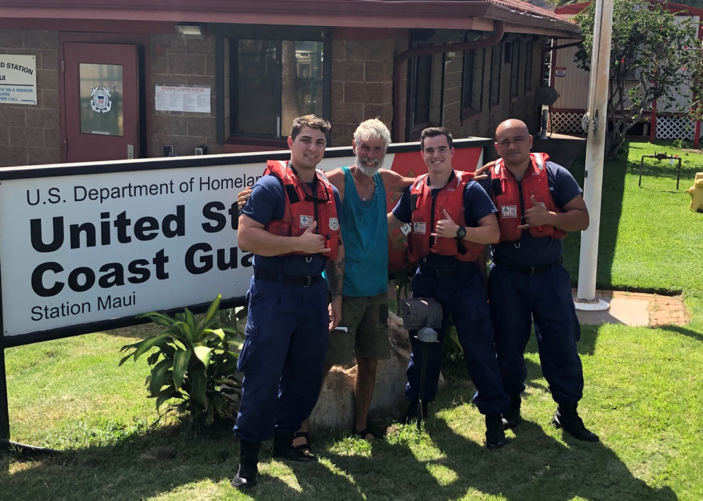 A Coast Guard Station Maui 45-foot Response Boat-Medium crew with a rescued boater arrive safely at Coast Guard Station Maui, USCG rescues boater Kahoolawe