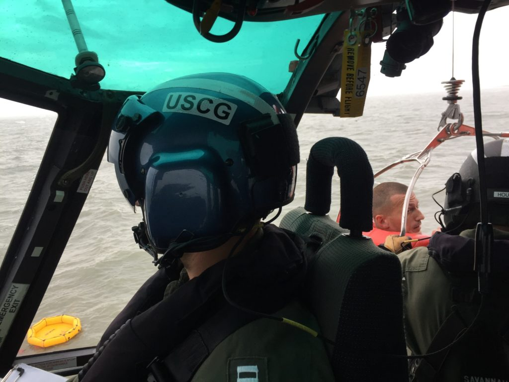 MH-65 Dolphin rescue helicopter crew from Air Station Savannah in rescue operation, Coast Guard Wassaw Sound