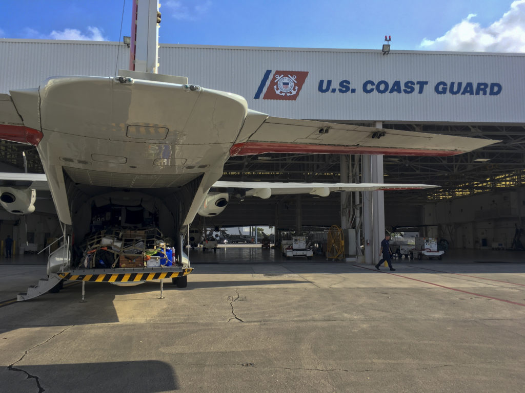 Coast Guard Air Station Miami HC-144 Ocean Sentry. USCG searching Blue Proline
