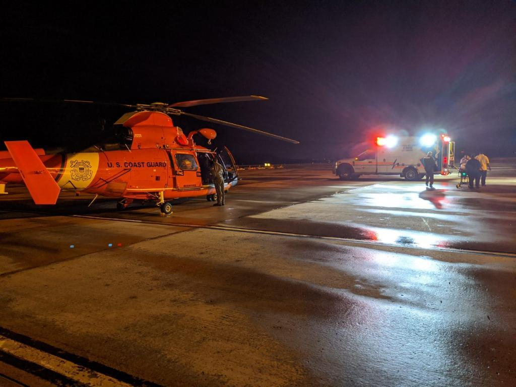 The crew of a Coast Guard Air Station Borinquen MH-65 Dolphin Helicopter with the Emergency Medical Services personnel in Saint Croix, who transported the patient to the Juan F. Luis Hospital for a higher level of medical care.