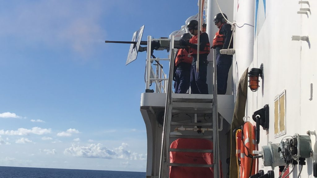 Crewmembers aboard the Coast Guard Cutter Mohawk (WMEC-913) conduct a gunnery exercise with a .50-caliber Browning M2HB machine gun in the Caribbean Sea.