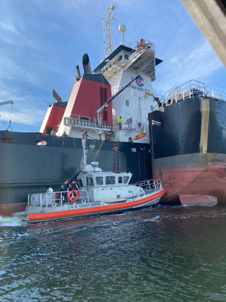A Station St. Petersburg 45-foot Response Boat-Medium crew medevacs a man from the 142-foot tug ATV Legend in Tampa Bay, Florida, Nov. 27, 2019. The man reportedly injured his right leg after falling from a ladder and was transported to Tampa General Hospital.