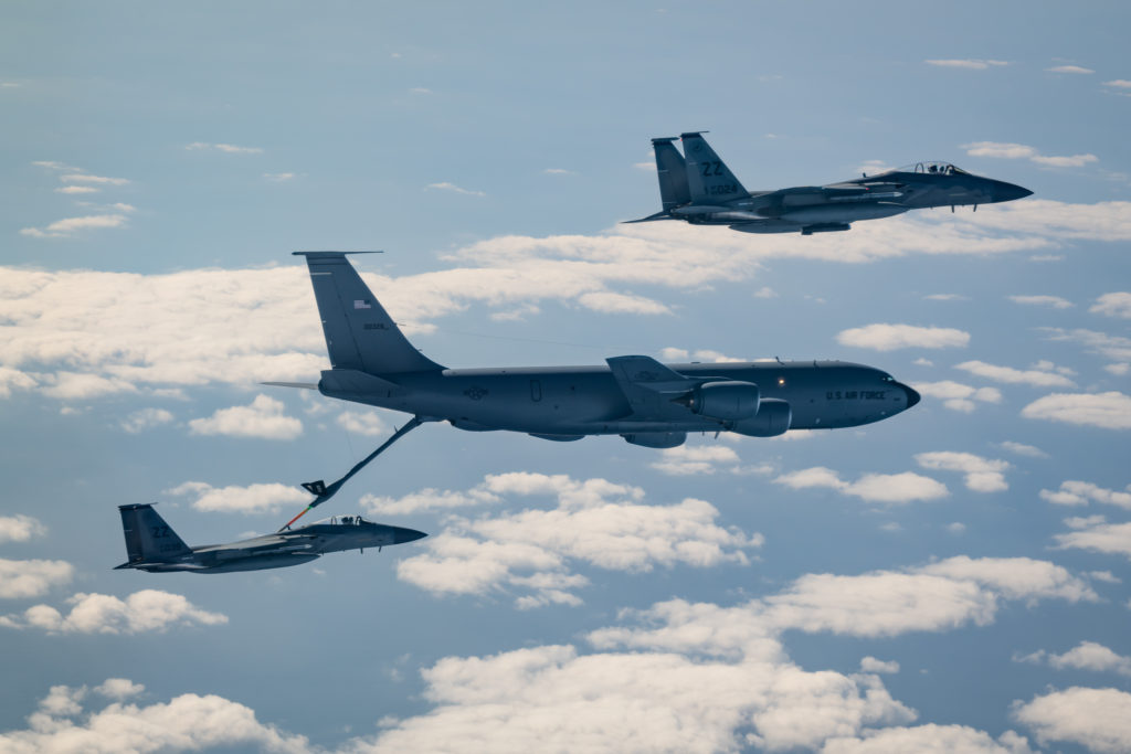 Two F-15C Eagles from the 44th Fighter Squadron refuel with a KC-135 Stratotanker from the 909th Air Refueling Squadron Jan. 10, 2020, during Exercise WestPac Rumrunner out of Kadena Air Base, Japan. Rumrunner represents an evolution in the capabilities of 18th Wing assets to work with joint partners to defend American allies and ensures a free and open Indo-Pacific.  U.S. Air Force photo by Senior Airman Matthew Seefeldt. 18th Wing WestPac Rumrunner