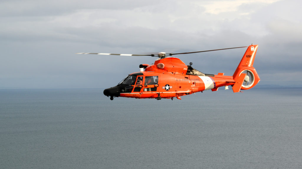 Coast Guard laser Helicopter. MH-65 Dolphin helicopter crew from Air Station Port Angeles flies of the Strait of Juan de Fuca, off the coast of Washington.. The Air Station has three Dolphin helicopters and is responsible for search and rescue response across the northern Washington coast.