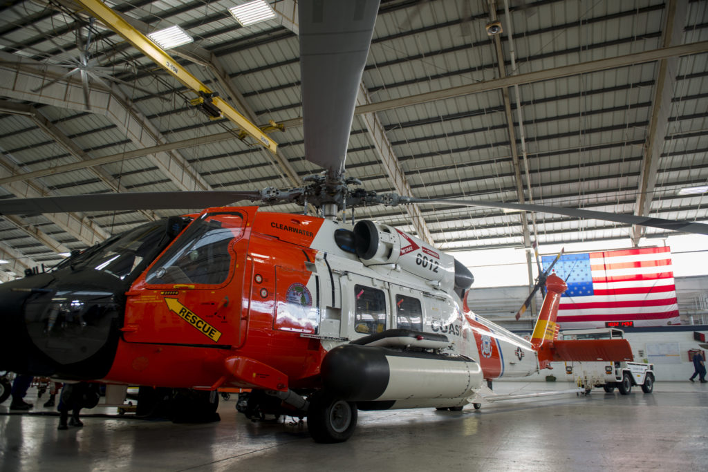 Coast Guard crew members from Air Station Clearwater prepare an MH-60 Jayhawk helicopter for deployment to Savannah, Georgia.