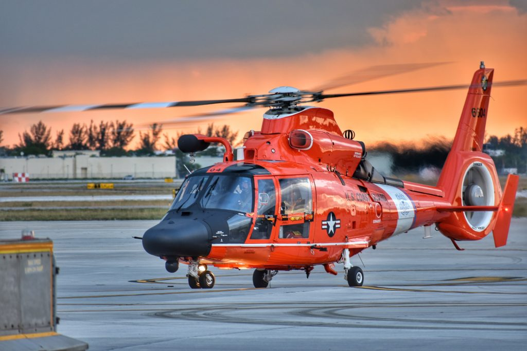 Coast Guard Air Station Miami aircrew prepares for an evening training flight, Monday, May 7, 2018 at Opa-locka Executive Airport in Opa-locka, Florida. Air Station Miami operates a fleet of five MH-65D Dolphin helicopters and five HC-144 Ocean Sentry aircraft.