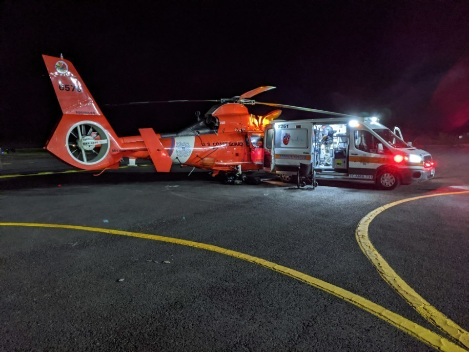 A Coast Guard Air Station Borinquen MH-65 Dolphin helicopter crew medically evacuates a man in Vieques, Puerto Rico, who experienced symptoms of a potential heart attack to a local hospital in San Juan, Puerto Rico Feb. 4, 2020.