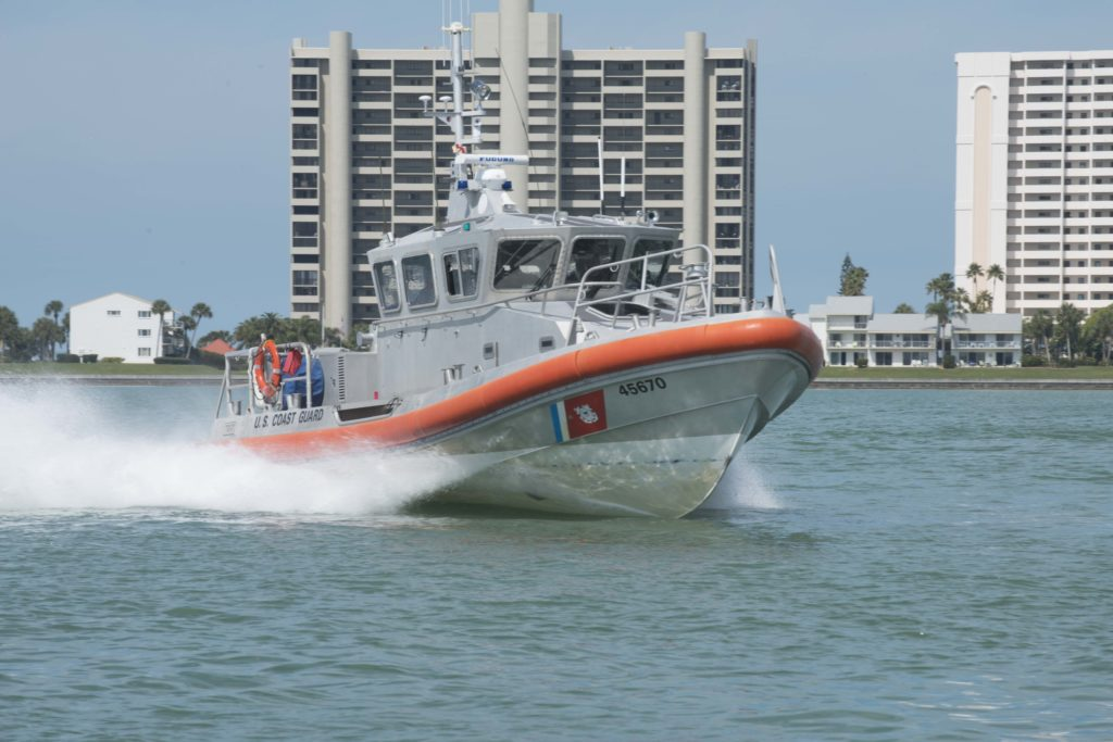 Coast Guard rescue 2 from overturned vessel off Clearwater, Florida. 45-foot Response Boat-Medium Coast Guard Station Sand Key.