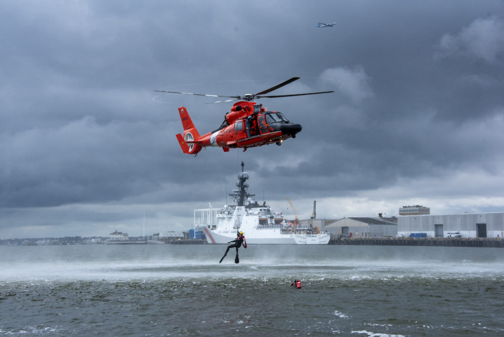 Coast Guard, partner agencies rescue 5 after vessel allides with Charleston jetty. MH-65 Dolphin Air Station Savannah on search and rescue demo in Charleston.