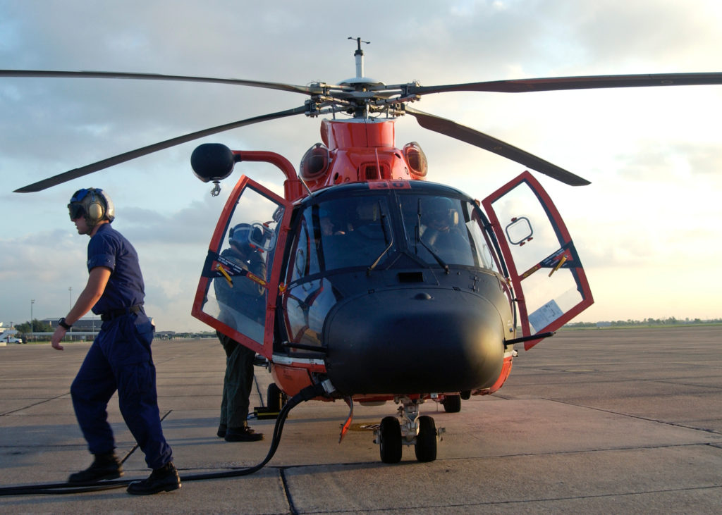 Coast Guard rescue 2​ jet skiers offshore Texas City, Texas. MH-65 Dolphin Air Station Houston. HH-65 Dolphin.