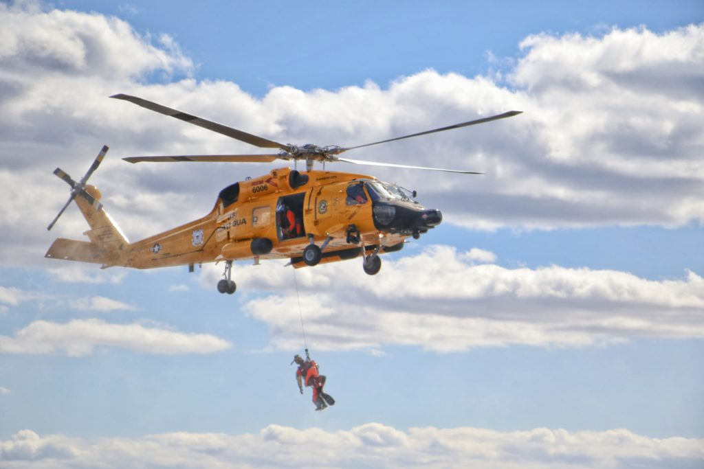 Coast Guard, Virginia Marine Resource Commission rescue jet skiers near Chincoteague, Virginia. MH-60 Jayhawk. MH-60J Jayhawk. Air Station Elizabeth City. Yellow MH-60 Jayhawk.
