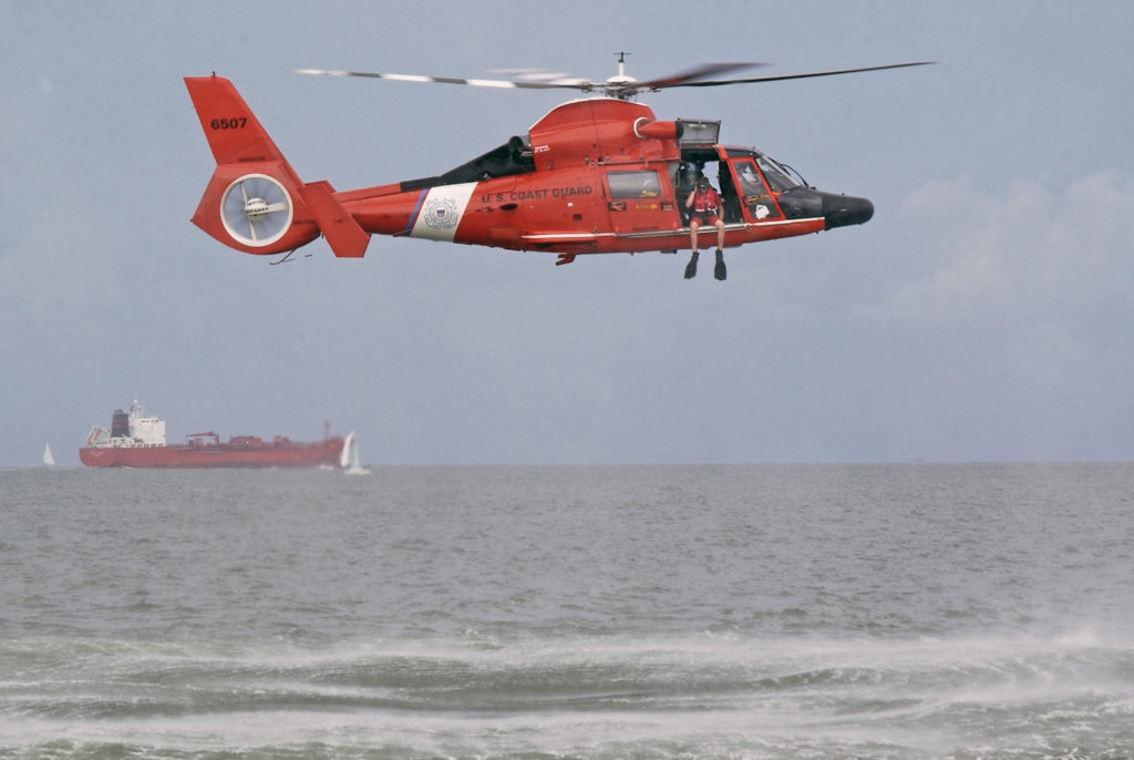Coast Guard medevac mariner 35 miles offshore Freeport, Texas. MH-65 Dolphin. Air Station Houston.