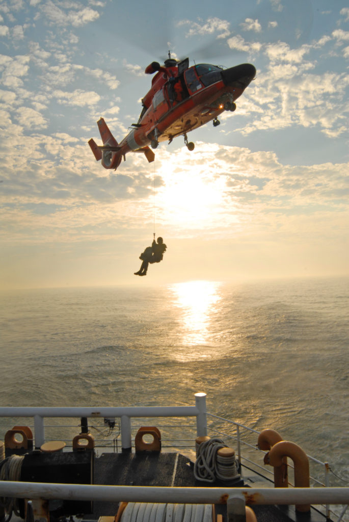 Coast Guard medevac crewmember from vessel 69 miles off Savannah, MH-65 Dolphin