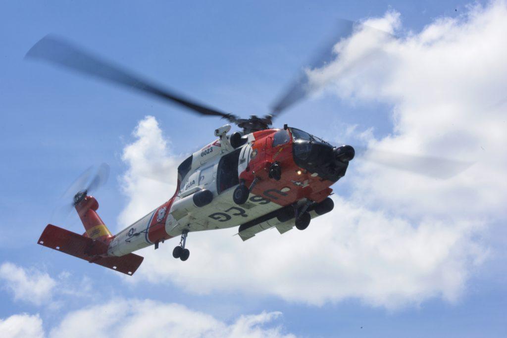 Coast Guard rescue mariner stranded in surf near Fisherman Island, MH-60 Jayhawk Air Station Elizabeth City