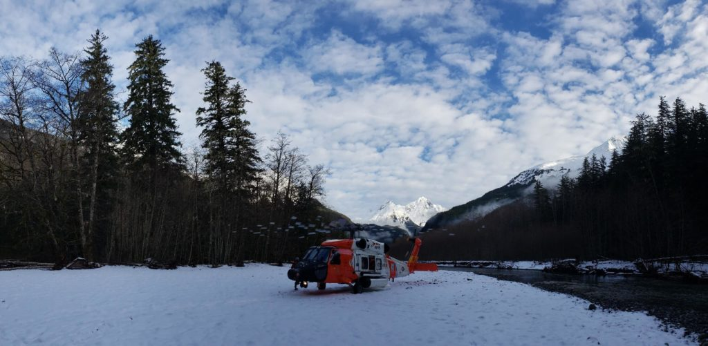 Coast Guard aircrew rescue 3 stranded mariners and 2 dogs on the Gilkey River