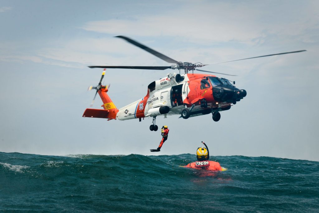 Coast Guard rescue 5 from burning vessel, Nobska, 85 nm E of Cape Cod