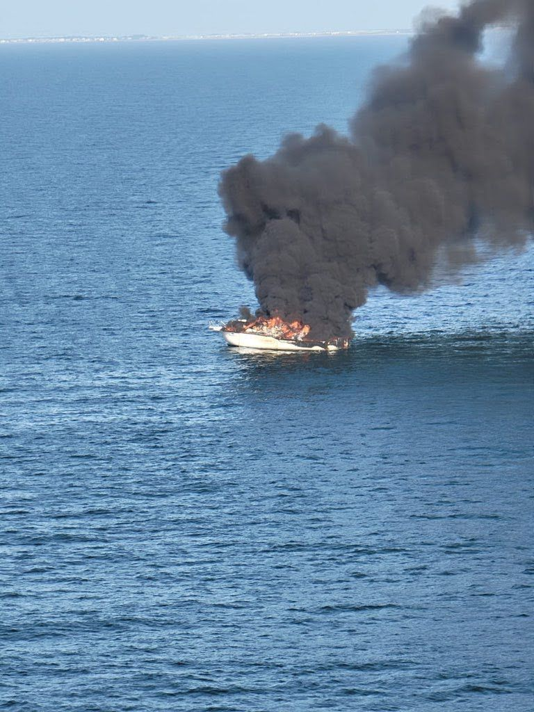 Coast Guard rescue 5 from boat fire 5 nm off Capers Inlet