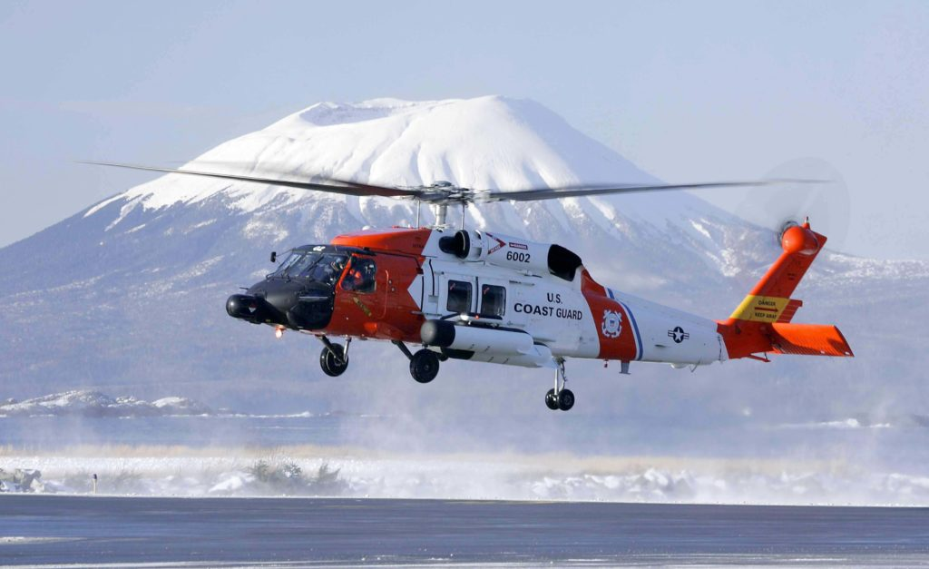 Coast Guard Sitka MH-60T Jayhawk aircrew rescue three from Chilkat River