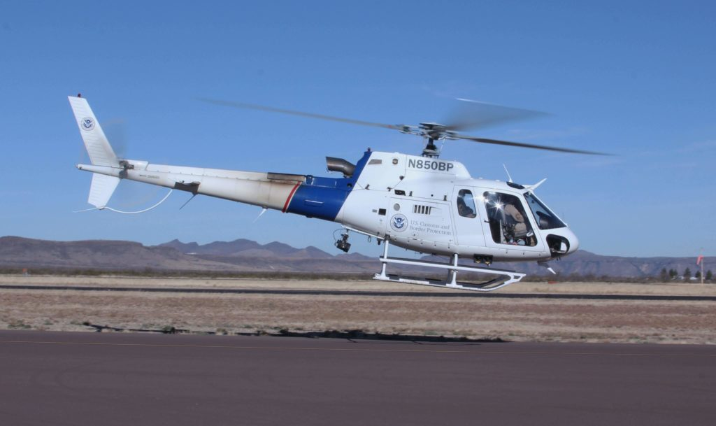 CBP Air and Marine Operations helicopter aircrew rescue man